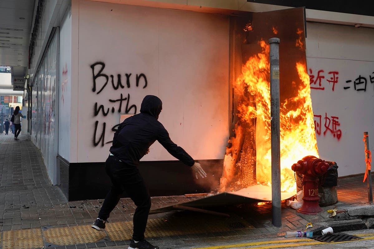 A protester sets fire to the cardboards outside the Bank of China branch during a protests in the Central district of Hong Kong. (File photo: AFP)