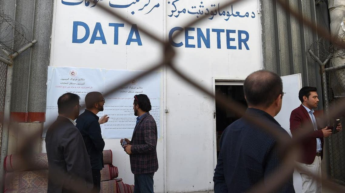 Observations and Independent Election Commission (IEC) officials look on in front of the Data Centre in Kabul on October 2, 2019. (AFP)