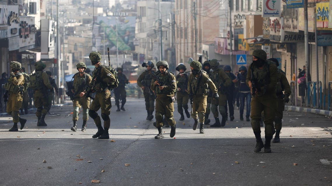 Israeli soldiers deploy doing clashes with Palestinians following a protest against U.S. President Donald Trump's decision to recognize Jerusalem as the capital of Israel in the West Bank city of Hebron, Friday, Dec. 15, 2017. (AP)