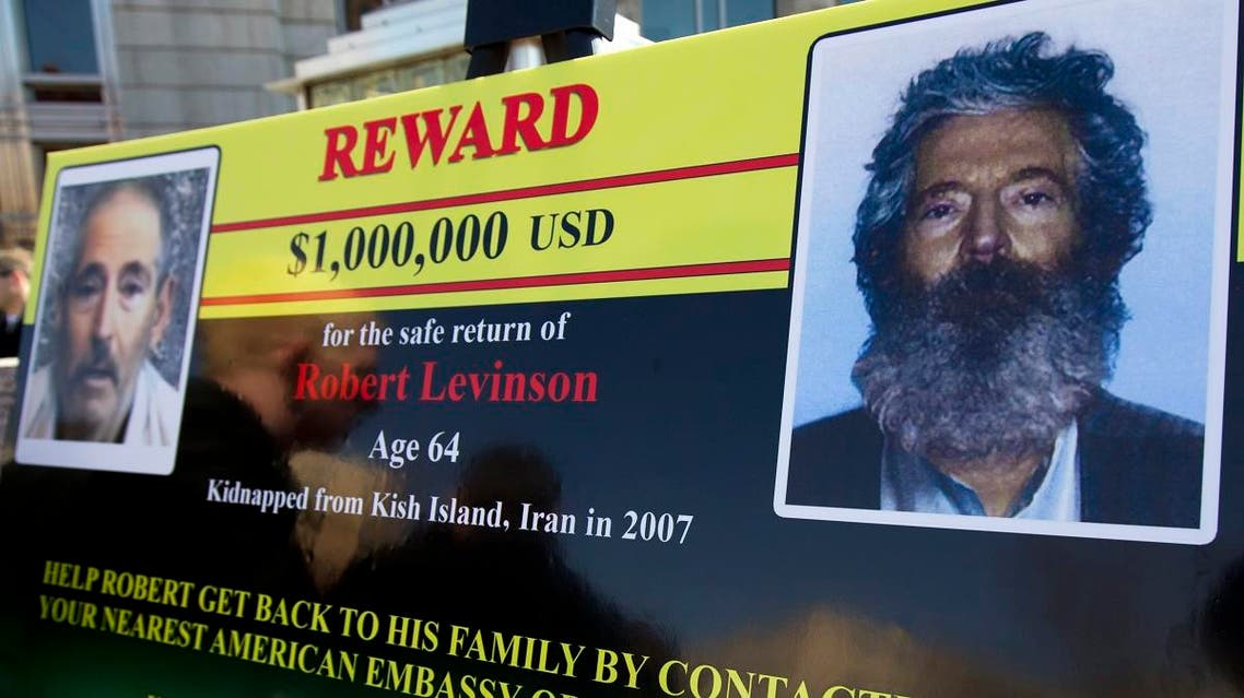 In this March 6, 2012 file photo, an FBI poster showing a composite image of former FBI agent Robert Levinson, right, of how he would look like now after five years in captivity. (AP)
