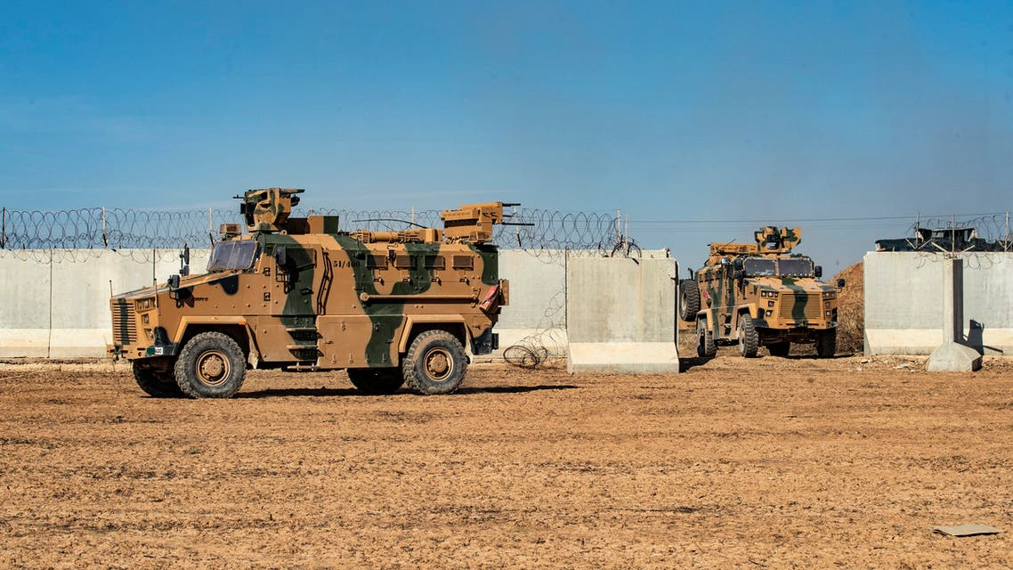 Turkish military vehicles are pictured during a Turkish-Russian army patrol near the town of Darbasiyah in Syria's northeastern Hasakeh province along the Syria Turkey border on November 11 2019