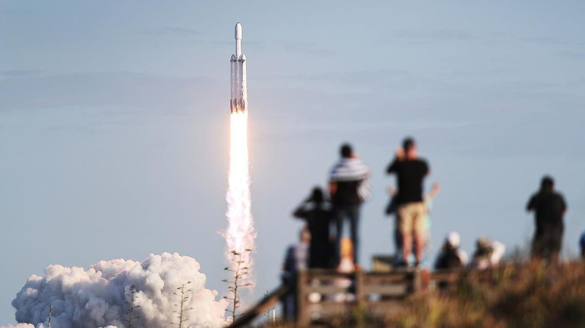 People watch as the SpaceX Falcon Heavy rocket lifts off from launch pad 39A at NASAs Kennedy Space Center on April 11, 2019. (AFP)