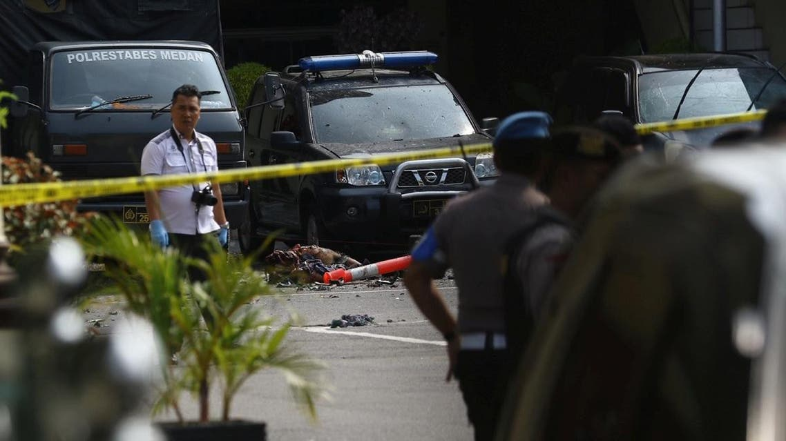 Police keep watch near the blast location after a suspected suicide bombing outside the police headquarters in Medan. (Reuters)