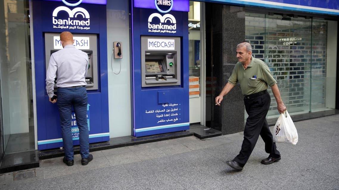 A man walks past a closed bank office in Beirut, Lebanon November 12, 2019. (Reuters)