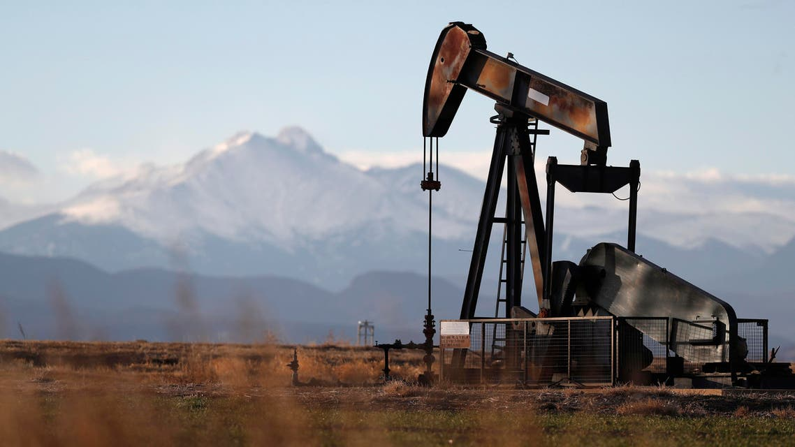 This Dec. 22, 2018, file photo shows a pump jack over an oil well along Interstate 25 near Dacono, Colorado (AP)