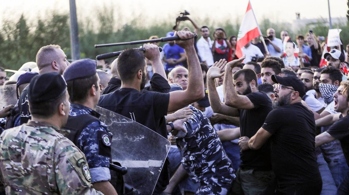 Lebanese demonstrators clash with anti-riot police on the road leading to the Presidential Palace in Baabda, on the eastern outskirts of Beirut on November 13, 2019. (AFP)