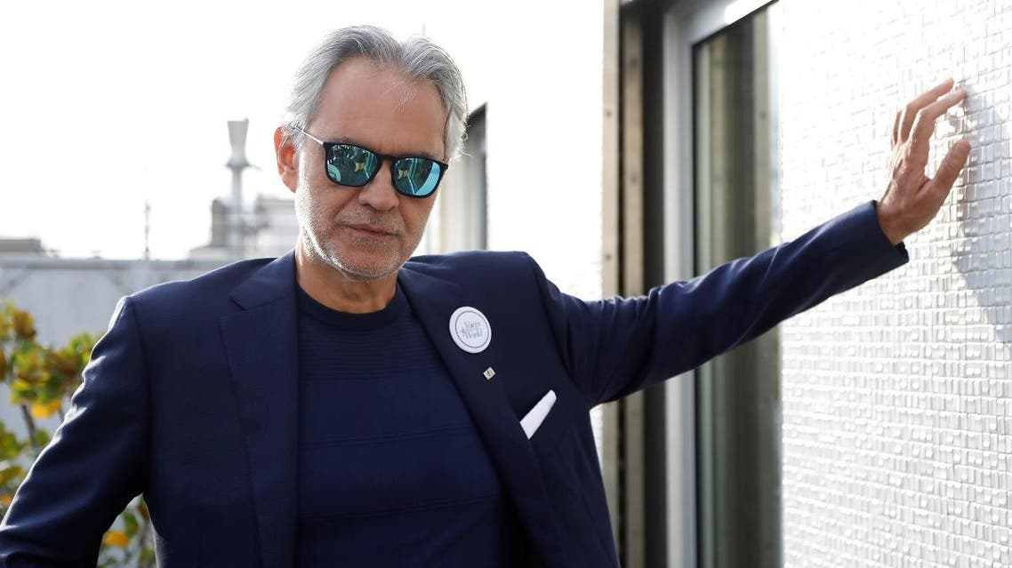 """Italian opera singer Andrea Bocelli poses after a news conference about his work with UNESCO program """"Voices of the World"""" in Paris, France, November 13, 2019. (Reuters)"""