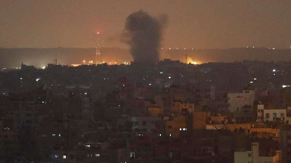 An explosion caused by Israeli airstrikes is seen in Gaza City, early Thursday. (AP)