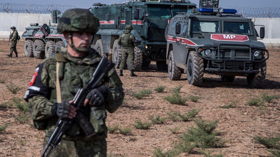 Turkish and Russian patrol is seen near the town of Darbasiyah, Syria, Friday, Nov. 1, 2019. (AP)