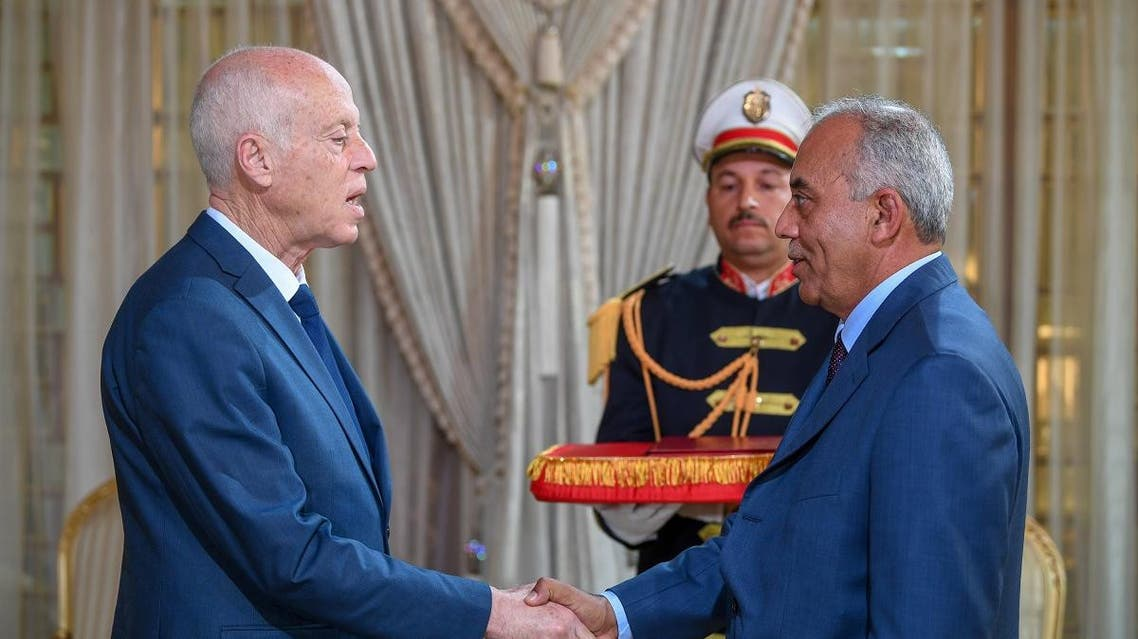 A handout picture provided by the Tunisian Presidency Press Service on November 15, 2019 shows Tunisia's President Kais Saied (L) receiving new Prime Minister Habib Jemli at the presidential palace. (AFP)