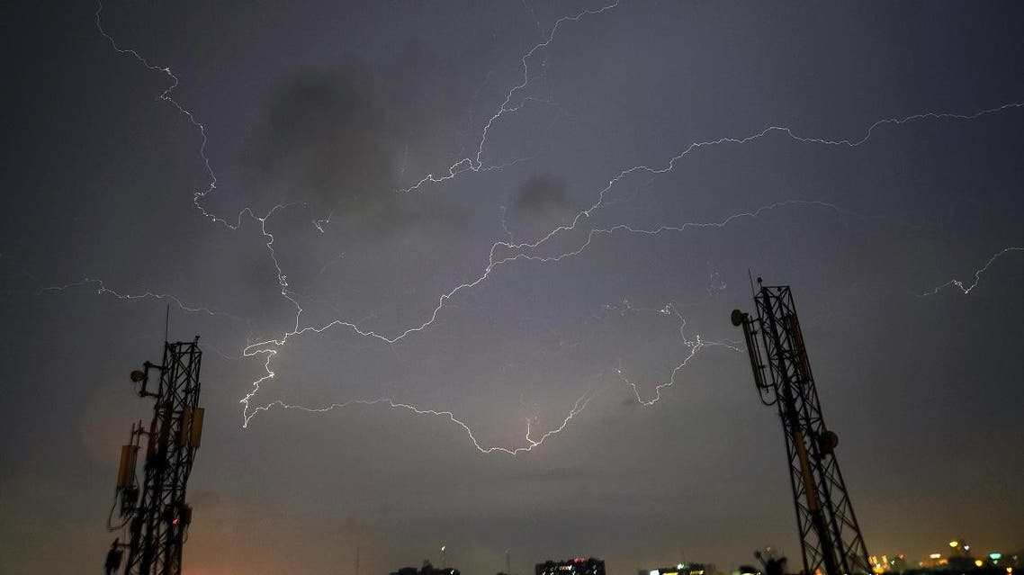 Lightning strikes over the Pakistan's port city of Karachi during a thunderstorm early on August 22, 2017. (AFP)