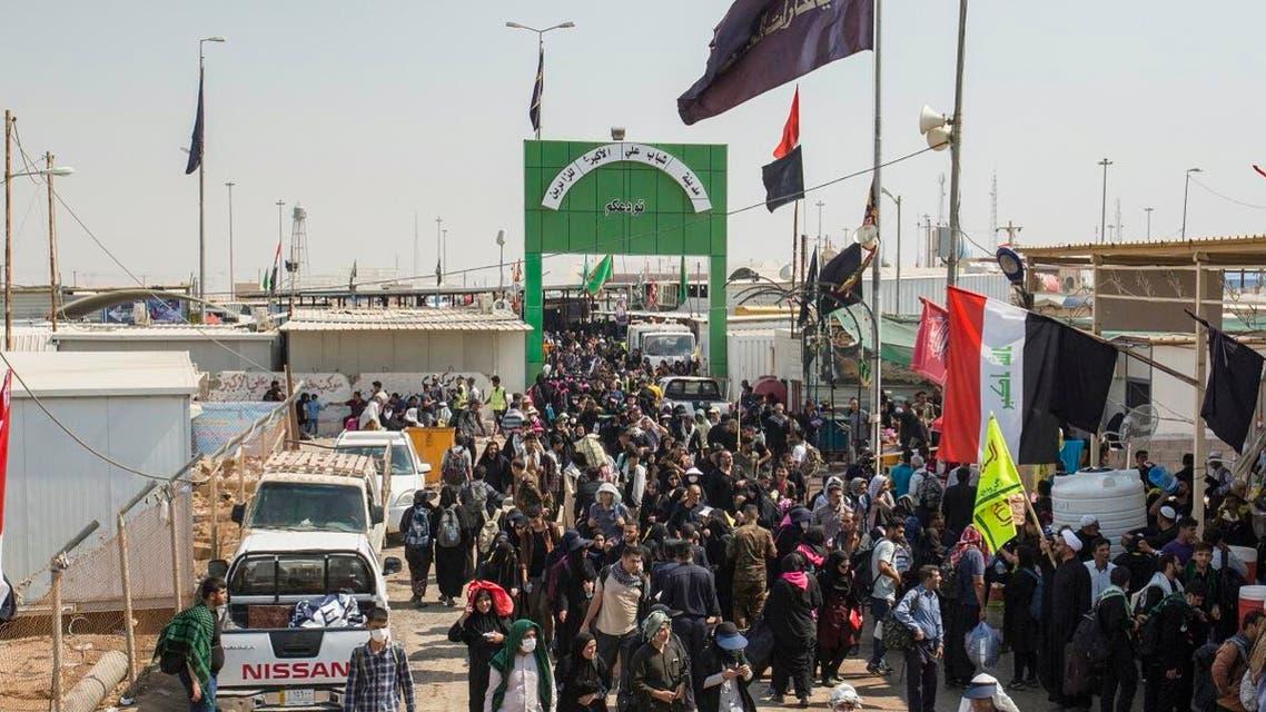 Shiite Muslim pilgrims pass through the Iran-Iraq Shalamjah border crossing to the southern Iraqi city of Basra on October 12, 2019. (AFP)