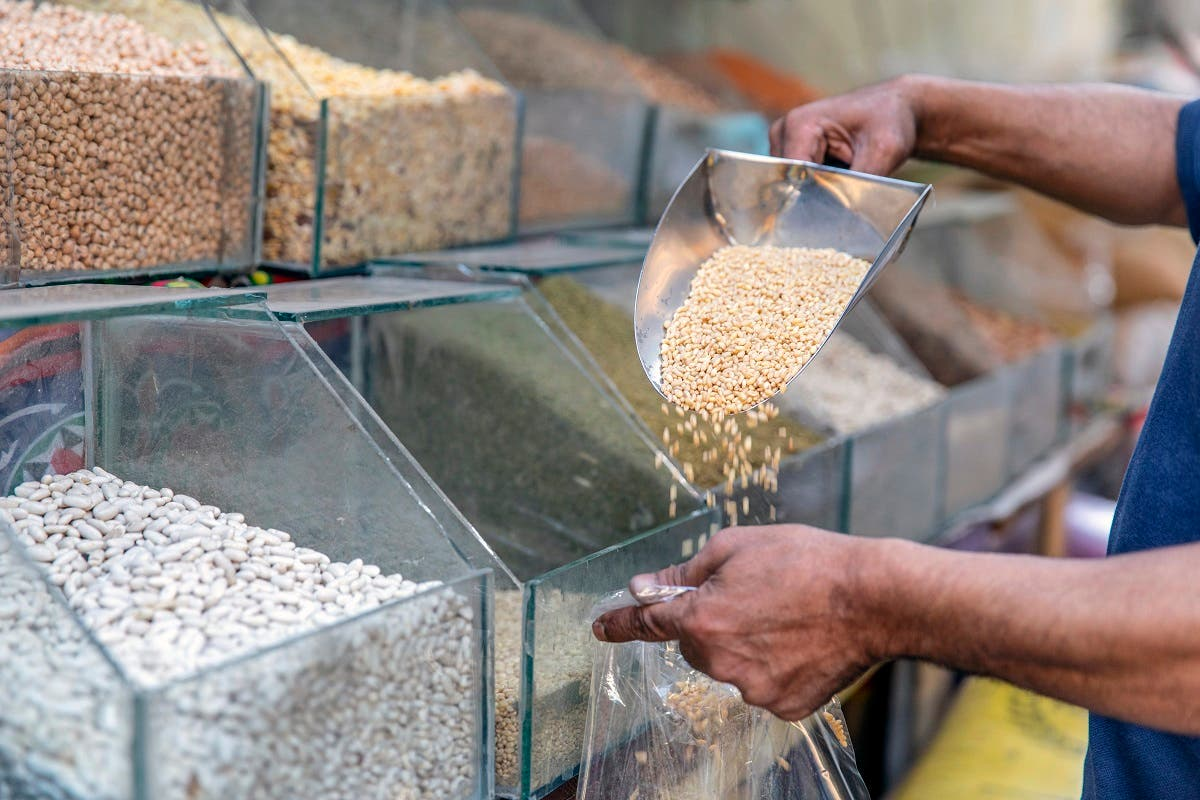 A merchant selling wheat seeds in a shop of Cairo, on June 27, 2019. (File photo: AFP)