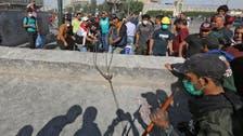 Protesters spill back onto bridge in Iraq capital