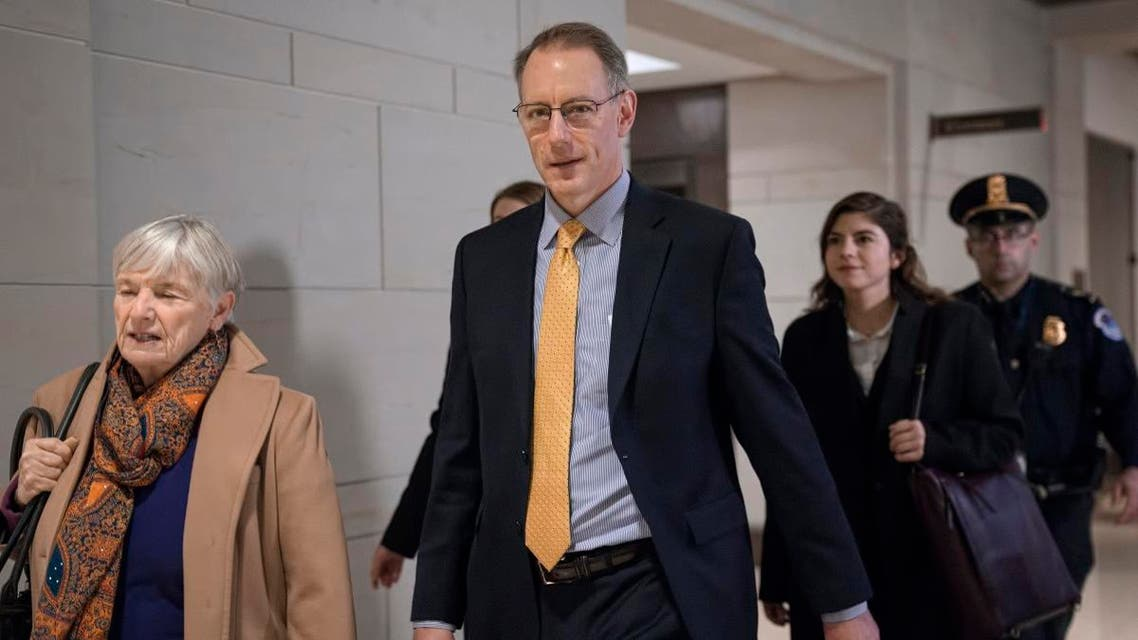 Mark Sandy, a career employee in the White House Office of Management and Budget, arrives at the Capitol to testify in the House Democrats' impeachment inquiry about President Donald Trump's effort to tie military aid for Ukraine to investigations of his political opponents, in Washington, Saturday, Nov. 16, 2019. (AP)