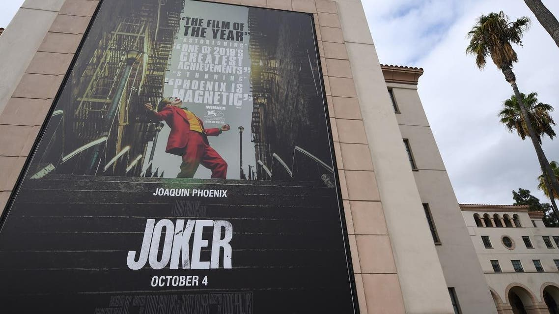 """A poster for the upcoming film """"The Joker"""" is seen outside Warner Brothers Studios in Burbank, California. (Reuters)"""