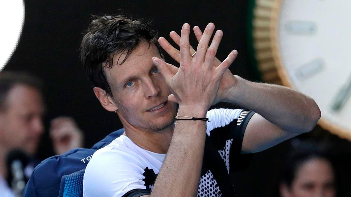 Tomas Berdych of the Czech Republic waves as he leaves Rod Laver Arena after his fourth round loss to Spain's Rafael Nadal at the Australian Open. (Reuters)