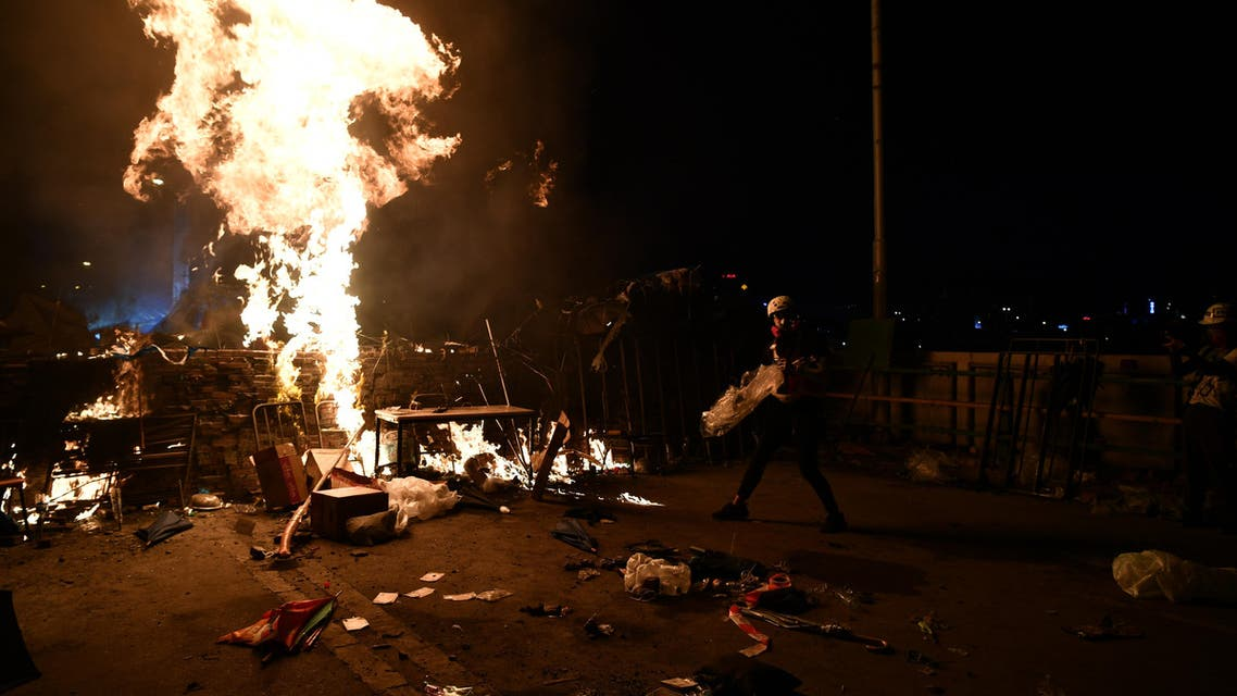 Protesters build a fire outside the Hong Kong Polytechnic University during clashes with the police in Hong Kong on November 17, 2019.  (AFP)