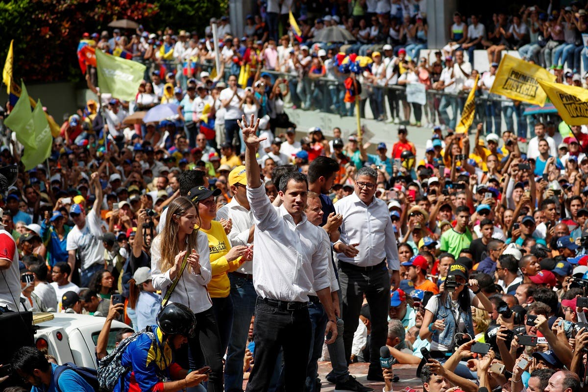 Venezuelan opposition leader Juan Guaido, who many nations have recognized as the country's rightful interim ruler, attends a protest march against Venezuela's President Nicolas Maduro in Caracas. (Reuters)