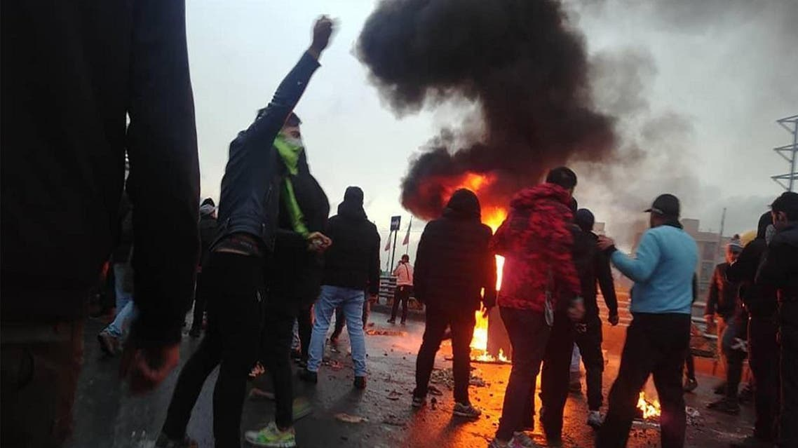 Iranian protesters gather around a fire during a demonstration against an increase in gasoline prices in the capital Tehran. (AFP)