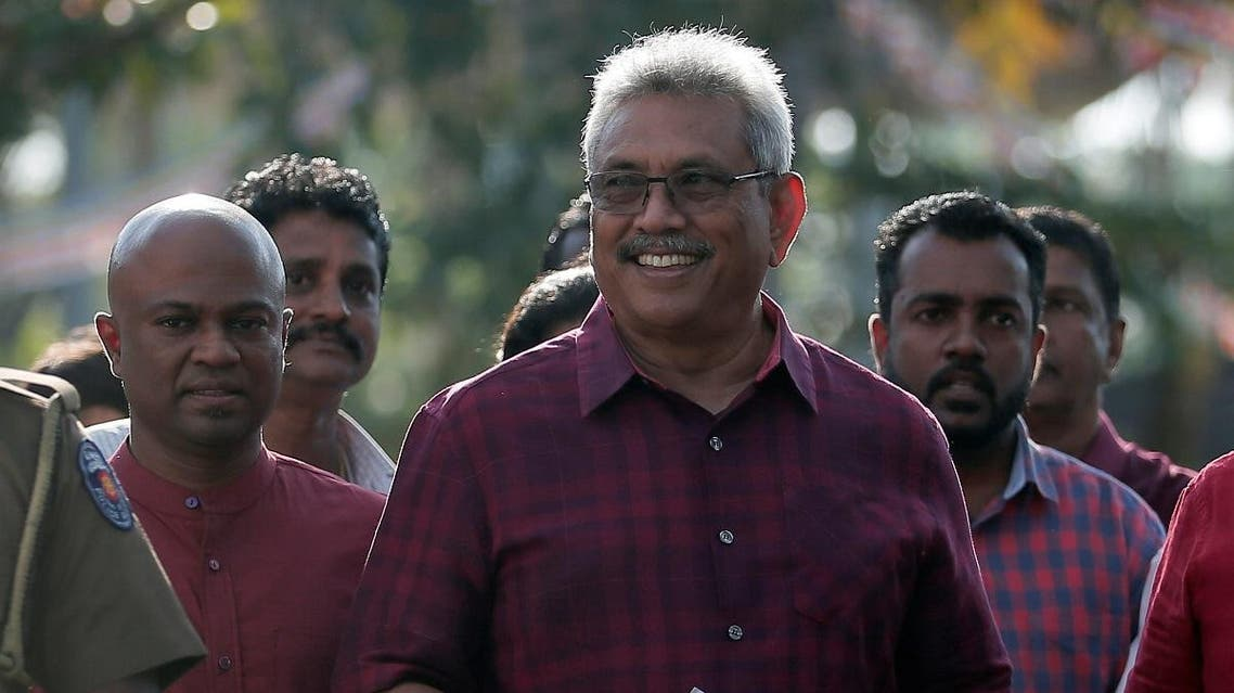 Sri Lanka People's Front party presidential election candidate and former wartime defense chief Rajapaksa leaves after casting his vote during the presidential election in Colombo. (Reuters)