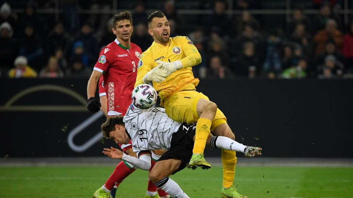 Belarus' goalkeeper Aleksandr Gutor and Germany's Luca Waldschmidt (L) vie for the ball during the UEFA Euro 2020 Group C qualification football match between Germany and Belarus, on November 16, 2019 in Moenchengladbach. (AFP)