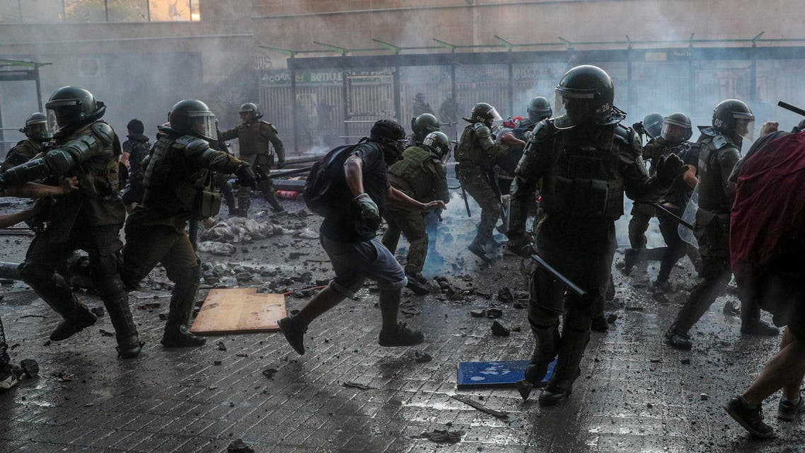 Chilean police clash with anti-government demonstrators during a protest in Santiago, Chile, Tuesday, Nov. 12, 2019. (AP)