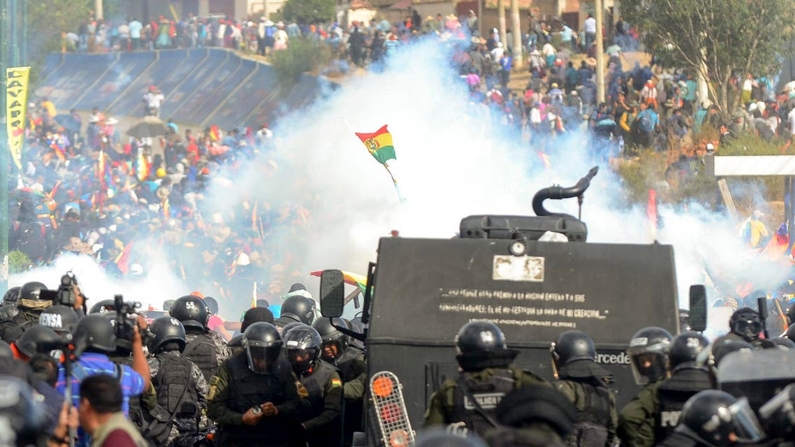 Bolivian riot police clash with supporters of Bolivia's ex-President Evo Morales during a protest against the interim government, in Sacaba, Chapare province, Cochabamba department on November 15, 2019. (AFP)