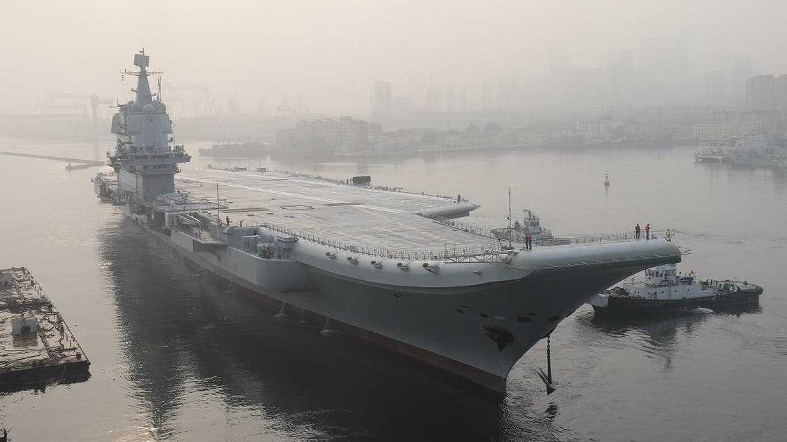 """In this file photo taken on May 13, 2018, China's first domestically manufactured aircraft carrier, known only as """"Type 001A"""", leaves port in the northeastern city of Dalian. (AFP)"""