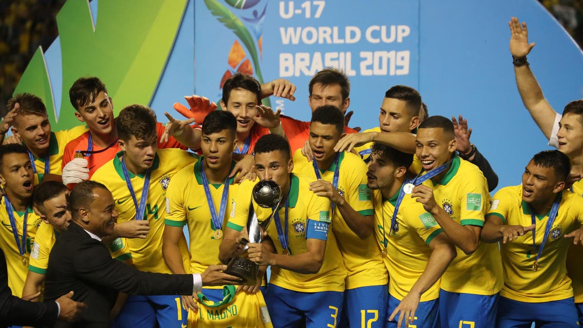 Brazil's Henri celebrates with the trophy after winning the FIFA Under 17 World Cup REUTERS