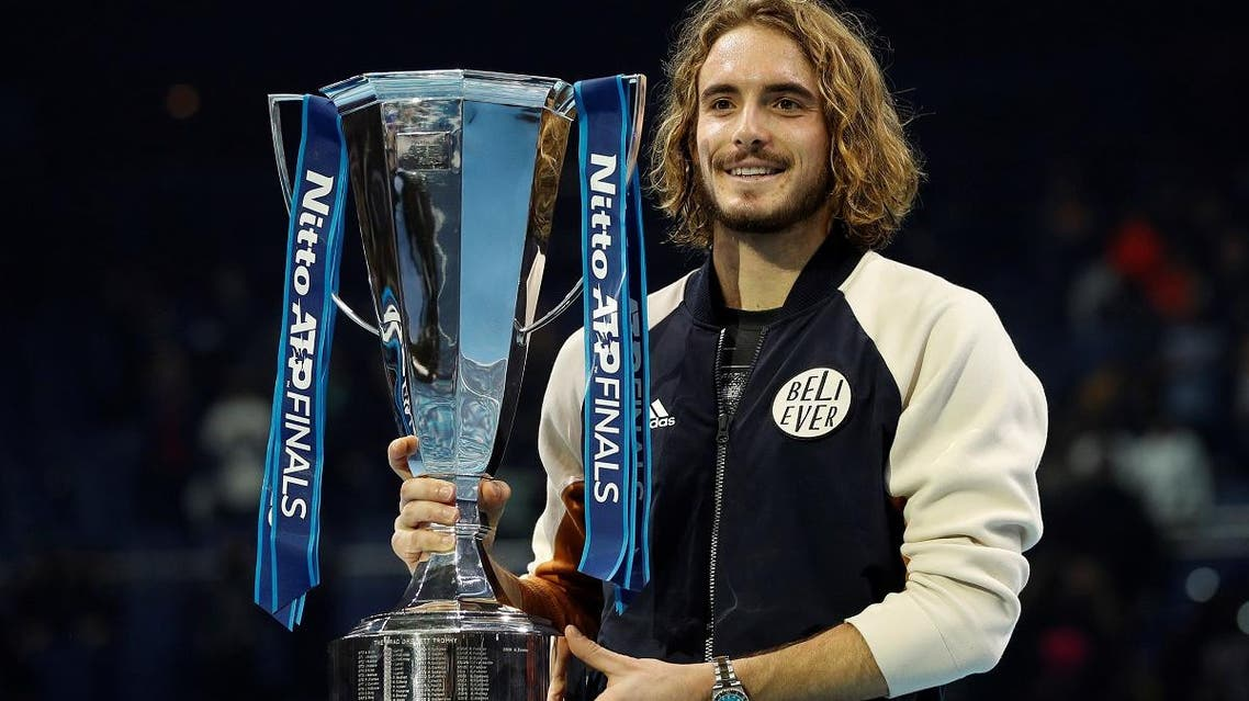 Stefanos Tsitsipas celebrates winning the ATP Finals with the trophy at the O2 in London on November 17, 2019. (Reuters)