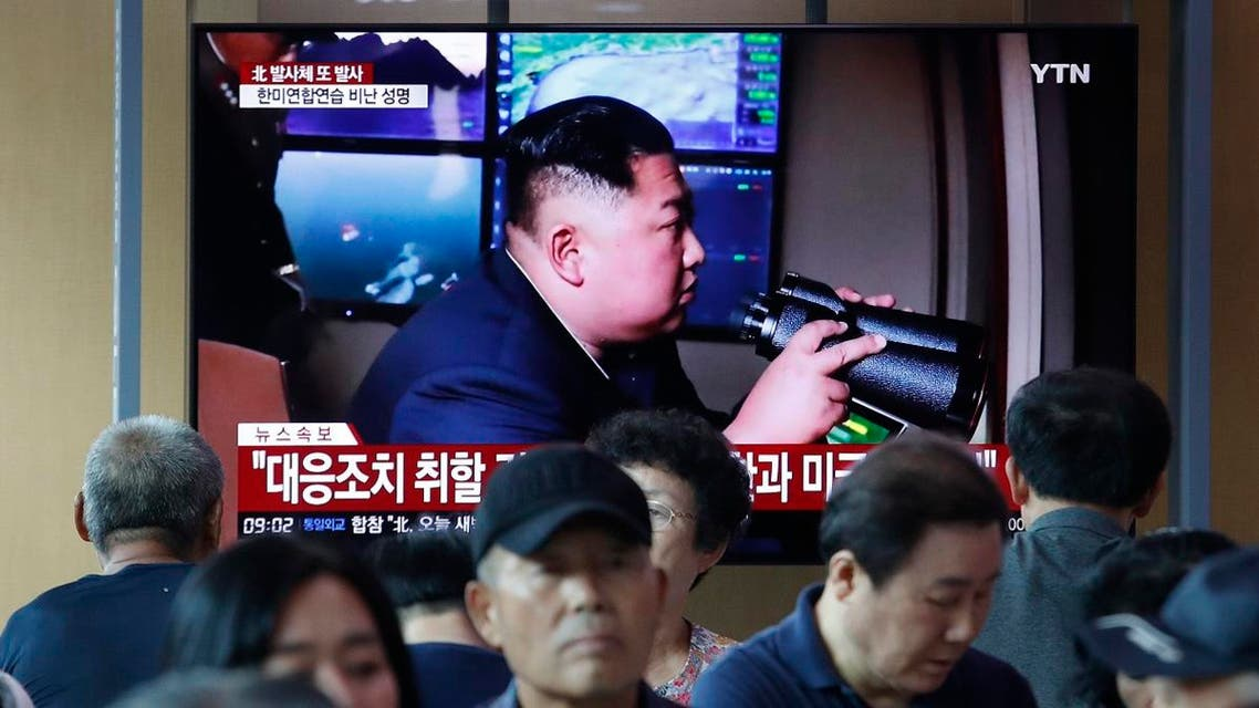 People watch a TV showing a file image of North Korean leader Kim Jong Un during a news program at the Seoul Railway Station in Seoul, South Korea, Tuesday, Aug. 6, 2019. (AP)