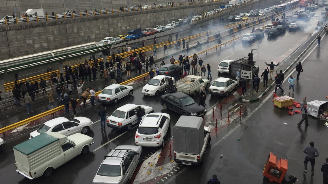Riot police tries to disperse people as they protest on a highway against increased gas price in Tehran IRAN AFP NOVEMBER 2019