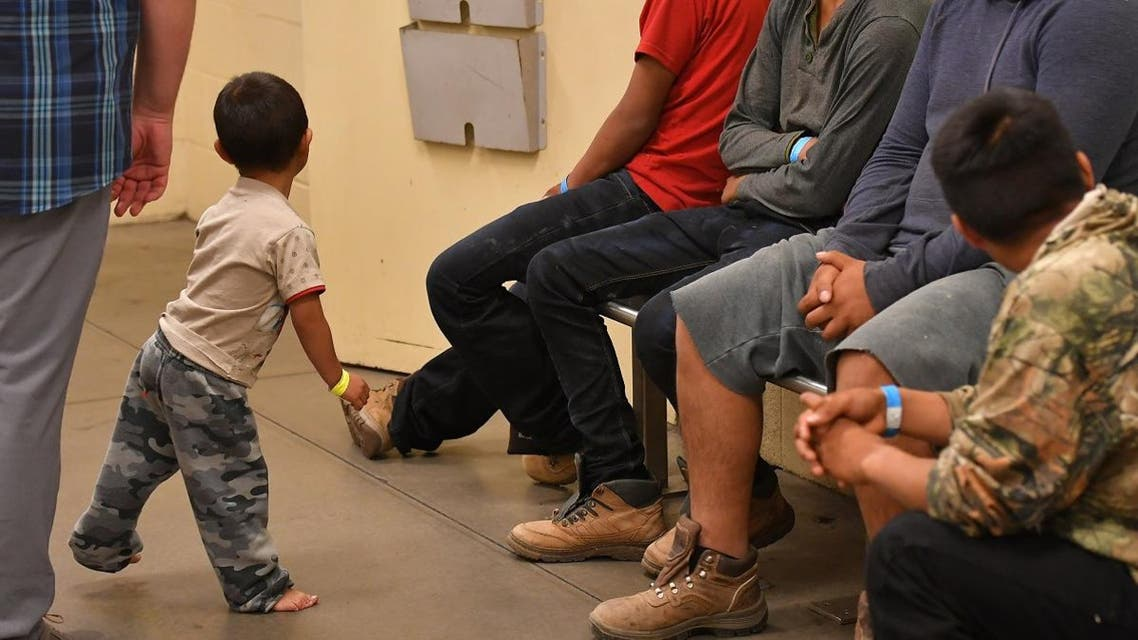 Young migrant children, whose faces can not be shown, are seen at the US Customs and Border Protection Facility in Tucson, Arizona June 28, 2018. (AFP)