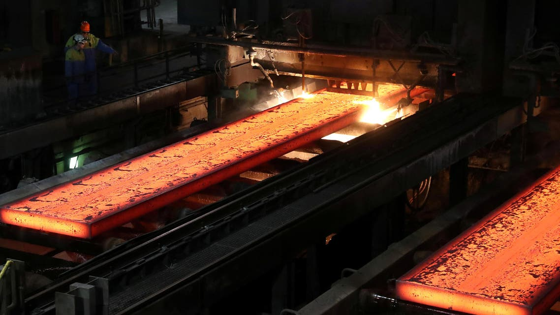 Red-hot steel plates pass through a press at the Tata steel plant in Ijmuiden, Netherlands. (Reuters)