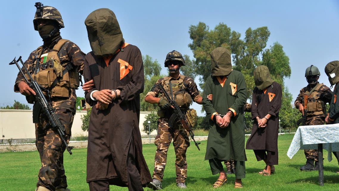 Afghan security personnel escort arrested alleged Taliban and ISIS militants during an operation in Jalalabad province on October 1, 2019. (AFP)