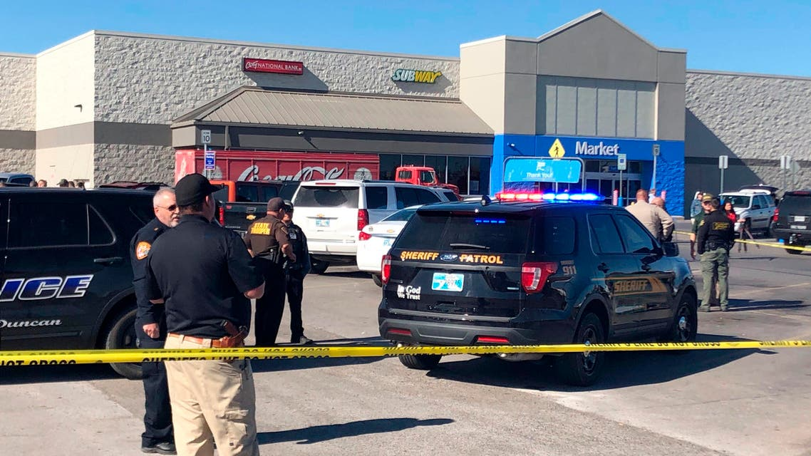 Law enforcement work the scene where two men and a woman were fatally shot on November 18, 2019, outside a Walmart store in Duncan, Oklahoma, in the US. (AP)