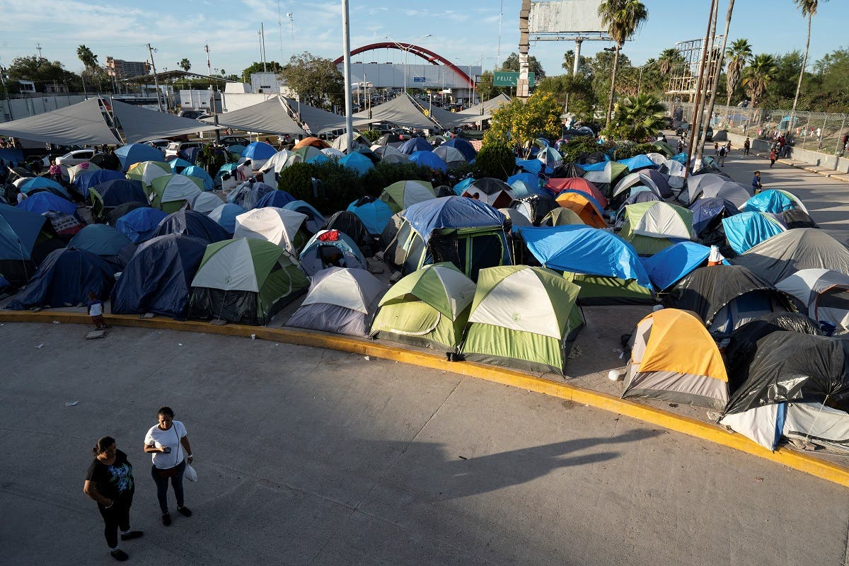 View of a migrants' camp on the Mexican border just south of the Rio Grande, in Matamoros, Tamaulipas state, Mexico, near to the border with the United States, on November 1, 2019. (AFP)