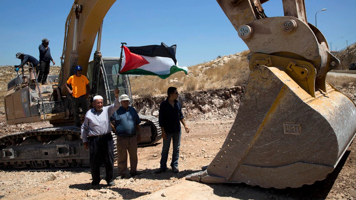 Palestinians demonstrated Wednesday in front of Israeli bulldozers that were bulldozing land outside Deir Qaddis village near Ramallah for an apparent plan to expand a nearby Jewish settlement. (AP)