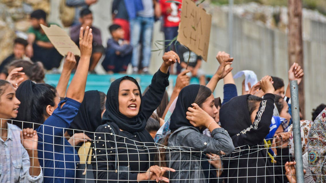 Refugees and migrants take part in a protest outside an overcrowded refugee camp on the Greek island of Samos, on Friday, Oct. 18, 2019. (AP)