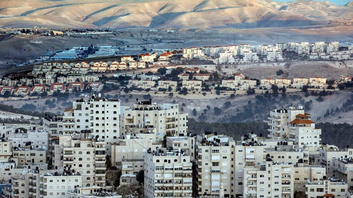 This picture taken on November 17, 2018 from East Jerusalem shows a view of the Israeli settlement of Maale Adumim (C) with the East Jerusalem Arab-inhabited Shuafat refugee camp. (AFP)