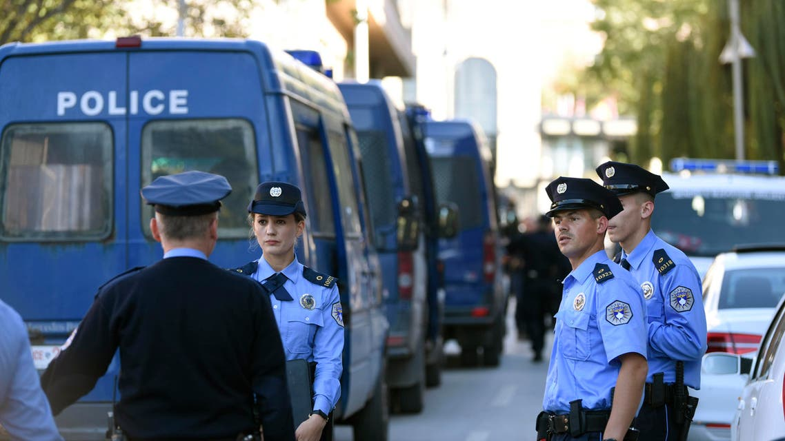 Kosovo police officers secure the area on October 13, 2019 in front of the Ministry of Infrastructure in Pristina (AFP)