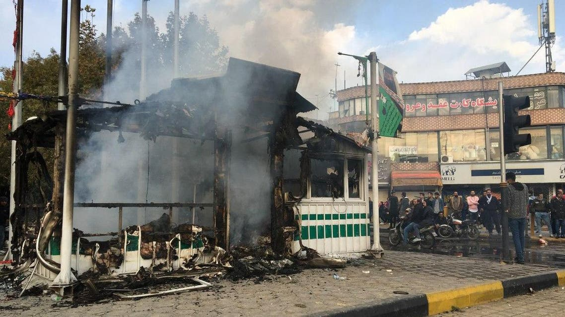 A police station that was set on fire during the protests - AFP