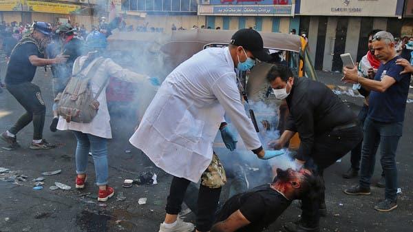 بغداد.. اشتباكات عنيفة بين المتظاهرين والأمن