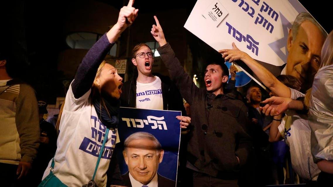 Supporters of Israeli Prime Minister Benjamin Netanyahu gather outside his residence in Jerusalem, on November 21, 2019. (AP)