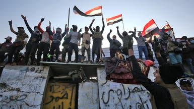 توافد المحتجين إلى وسط بغداد.. ومقتل 7 متظاهرين