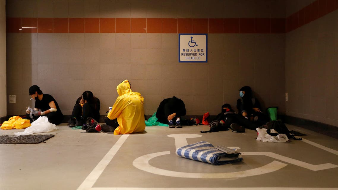 Anti-government protesters wait for an opportunity to escape through a sewer in an underground carpark at the Hong Kong Polytechnic University (PolyU) in Hong Kong, China, November 20, 2019. REUTERS