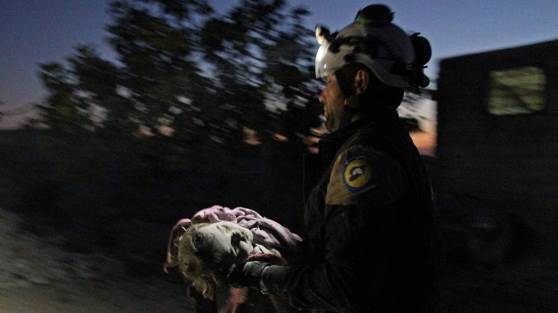A member of the Syrian Civil Defense (White Helmets) carries a young victim following a reported Russian airstrike on the town of Maaret al-Numan in Syria's northwestern Idlib province on November 20, 2019. (AFP)