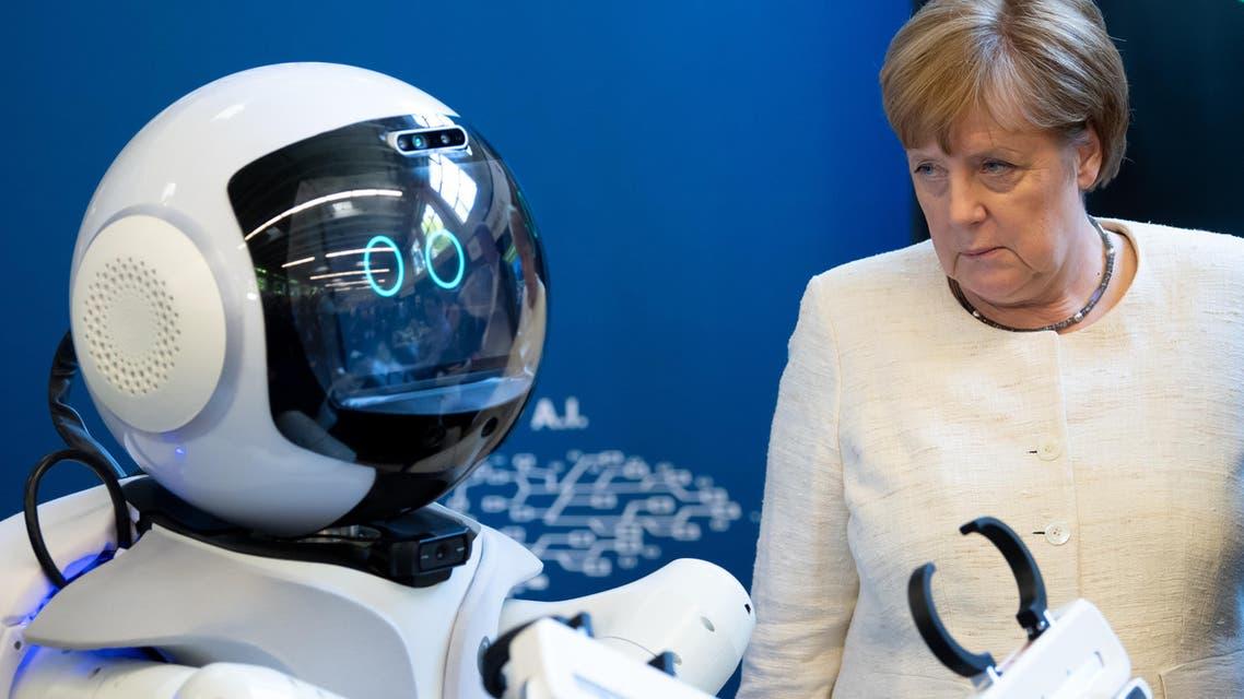 German Chancellor Angela Merkel with robot on May 24, 2019, Munich - AFP