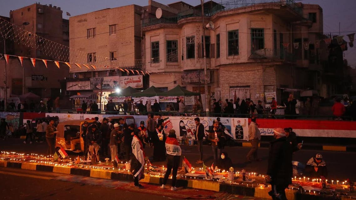 Iraqi anti-government protesters hold a candlelight vigil in Baghdad's Tahrir square on November 21, 2019 for comrades killed in demonstrations against corruption, unemployment and an out-of-touch political class. (AFP)